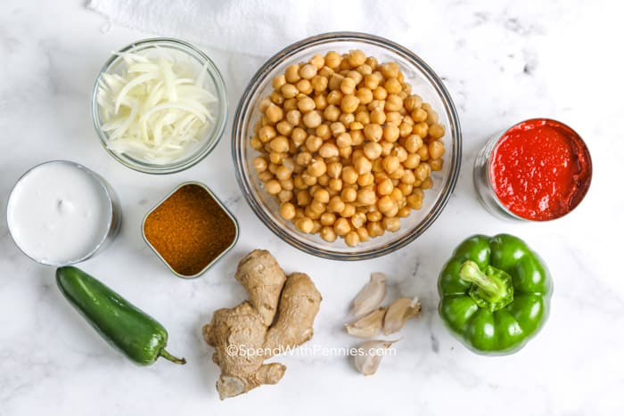 ingredients to make chickpea curry on a white counter