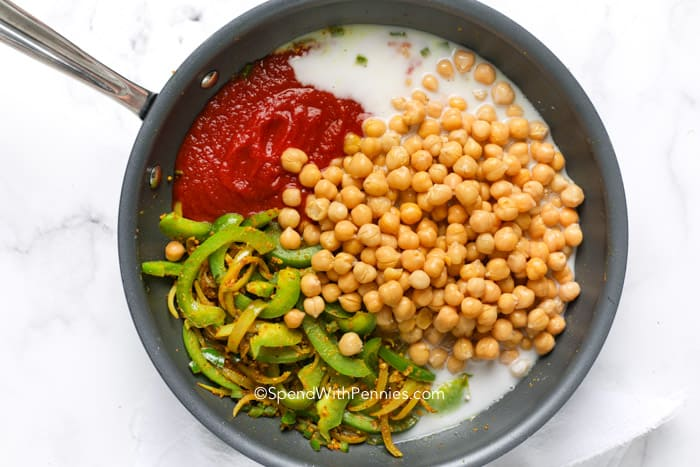 chickpea curry ingredients in a skillet