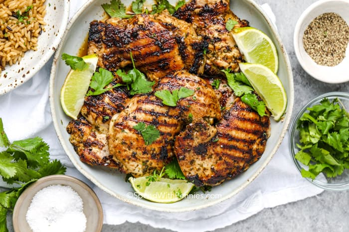 Cilantro lime chicken on a plate with seasonings