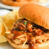 Shredded BBQ chicken sandwich with chips