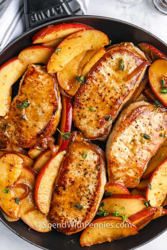 Fried Pork Chops with Apples in a frying pan