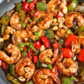 Kung Pao Shrimp over the top view in a frying pan