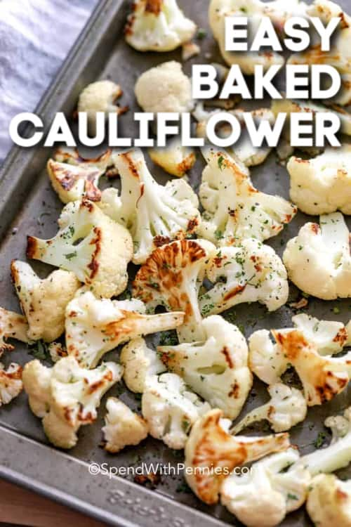 Baked cauliflower on a baking sheet with writing