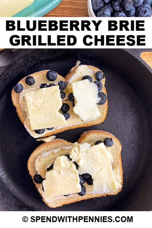 Open faced blueberry brie grilled cheese in a frying pan with writing