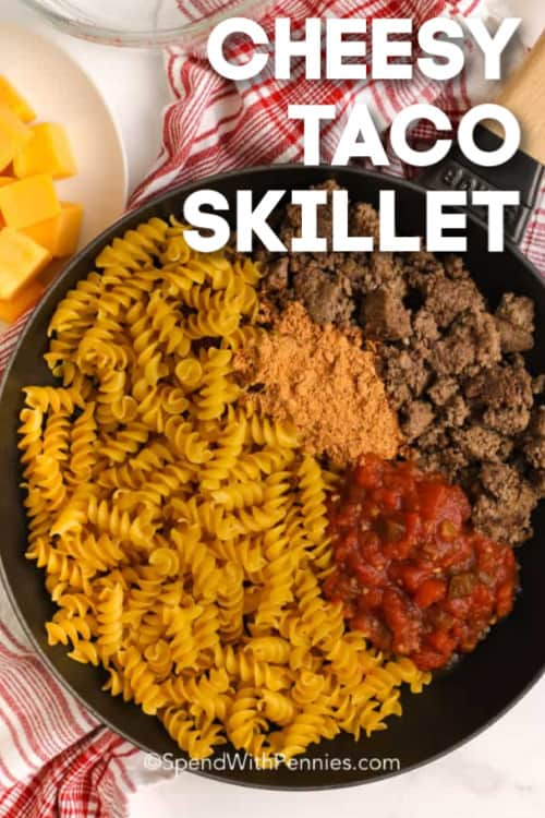 Taco skillet ingredients in a pan with writing