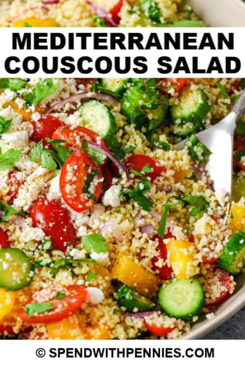 Couscous Salad with a silver serving spoon in a bowl with writing