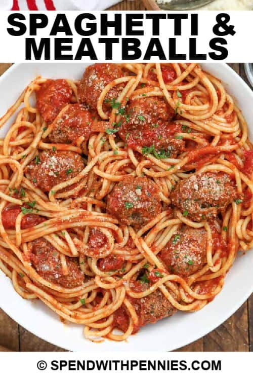 a serving of spaghetti and meatballs with writing