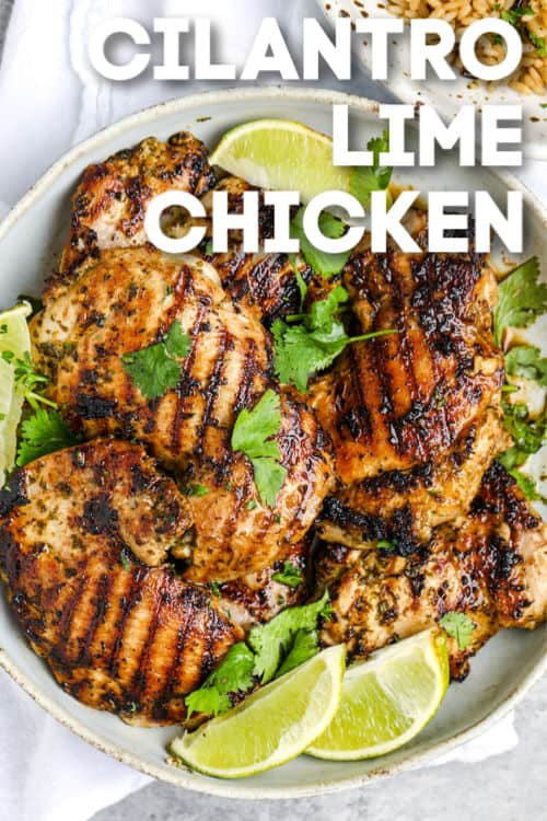 Cilantro lime chicken on a plate with lime wedges shown with a title