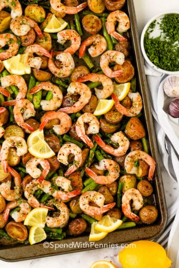 parsley and lemon over sheet pan roasted potatoes and shrimp
