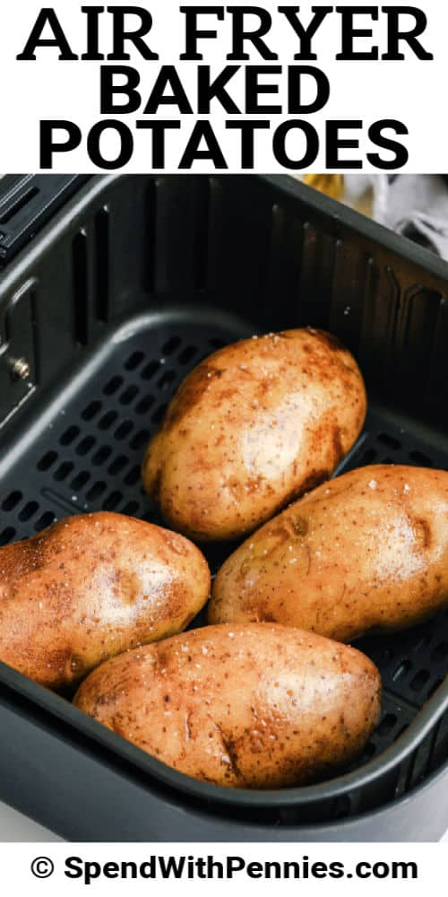 uncooked Air Fryer Baked Potatoes in an air fryer with writing