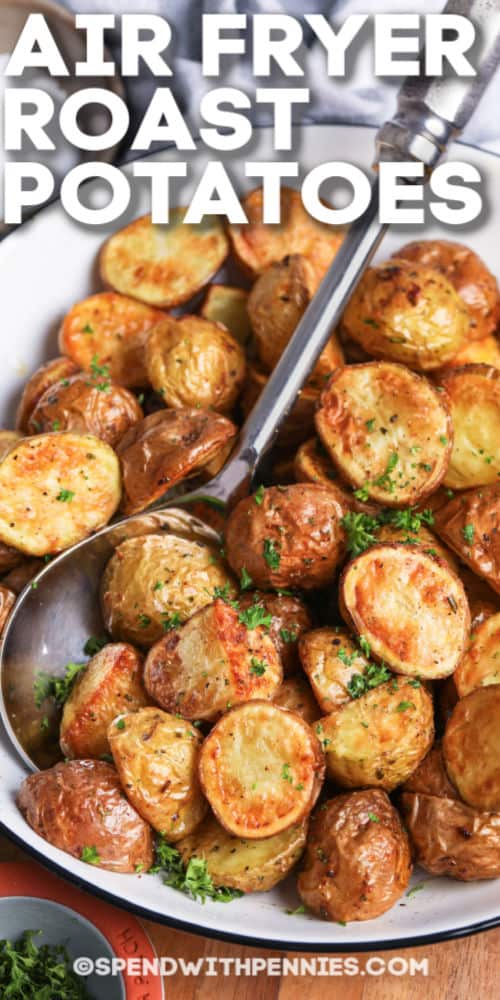 a serving dish of air fryer roast potatoes with writing