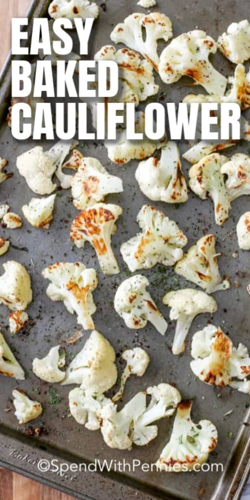Cauliflower florets on a baking pan with writing