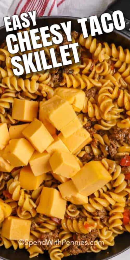 Cheesy Taco skillet ingredients in pan with writing