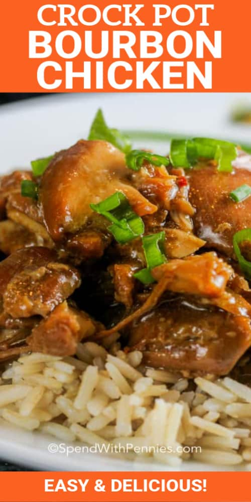 A plate full of Crock Pot bourbon chicken over rice garnished with green onions.