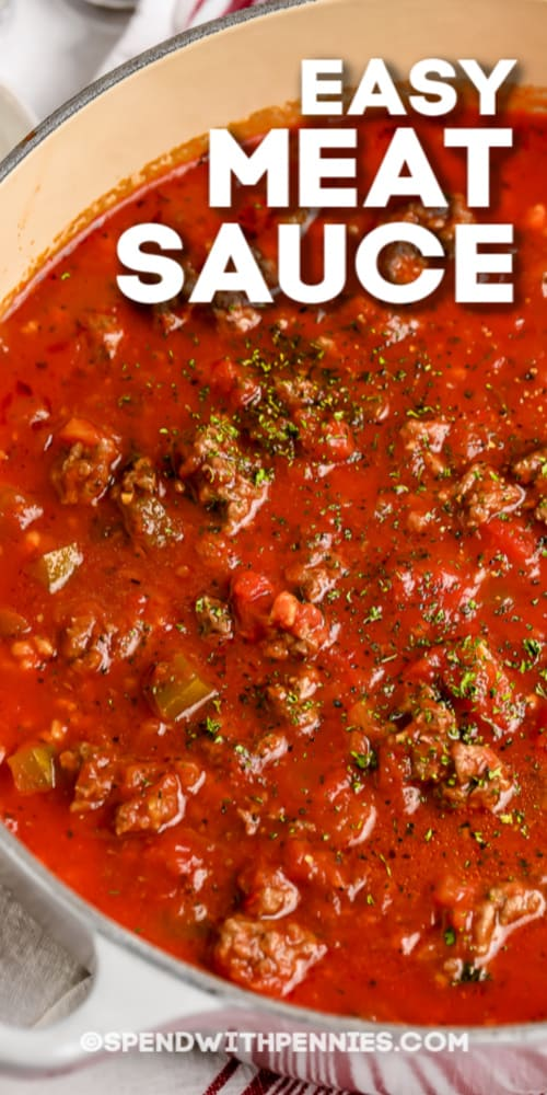 Meat sauce in a sauce pan with writing