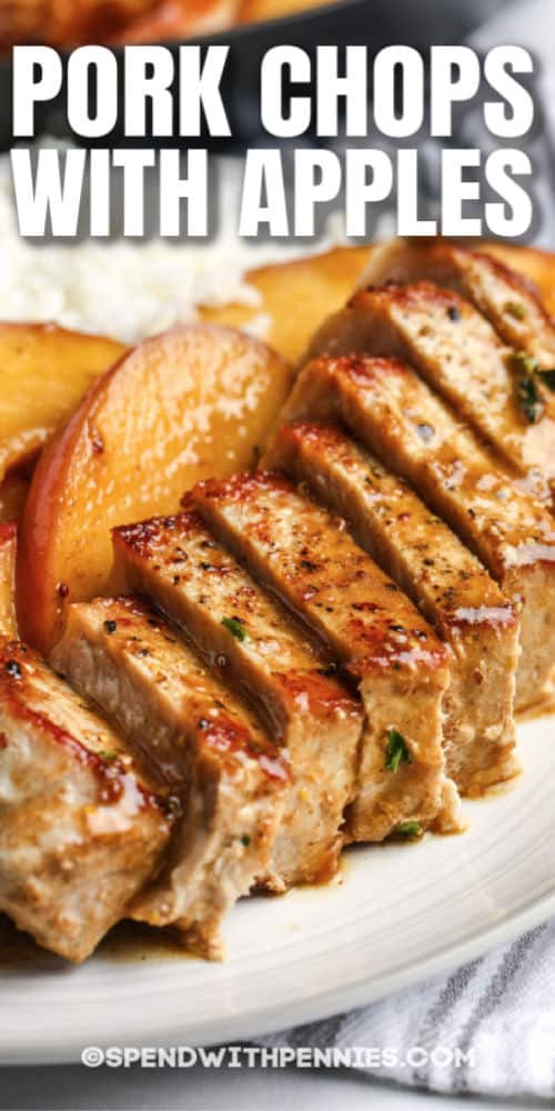 cut Fried Pork Chops with Apples on a plate with writing