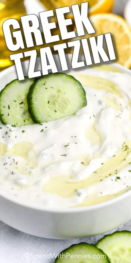 Greek Tzatziki in a bowl with two cucumber slices on top