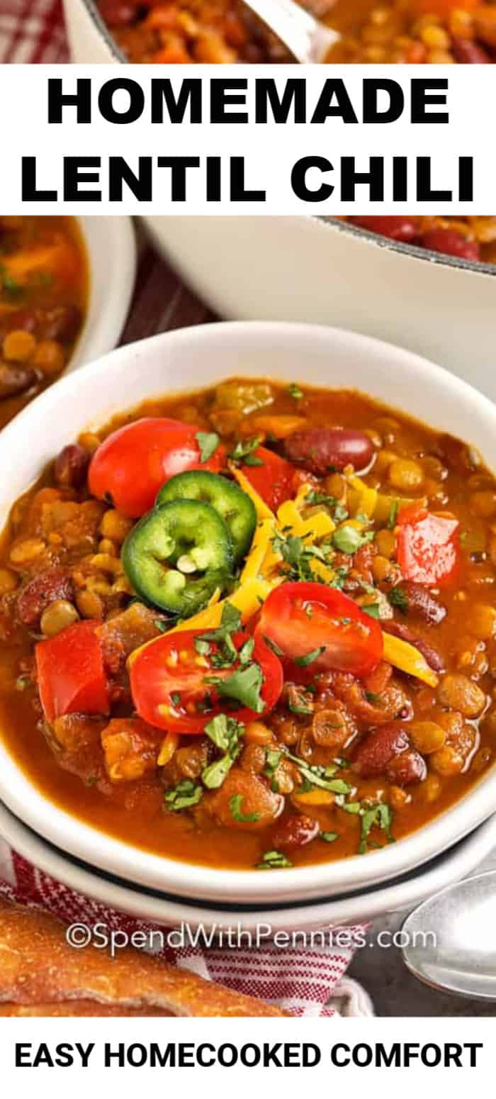 Lentil Chili served in a white bowl, garnished with jalapenos and tomatoes.