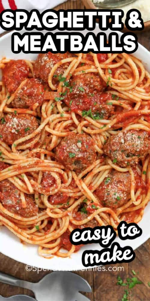 Spaghetti and Meatballs garnished with parsley with writing