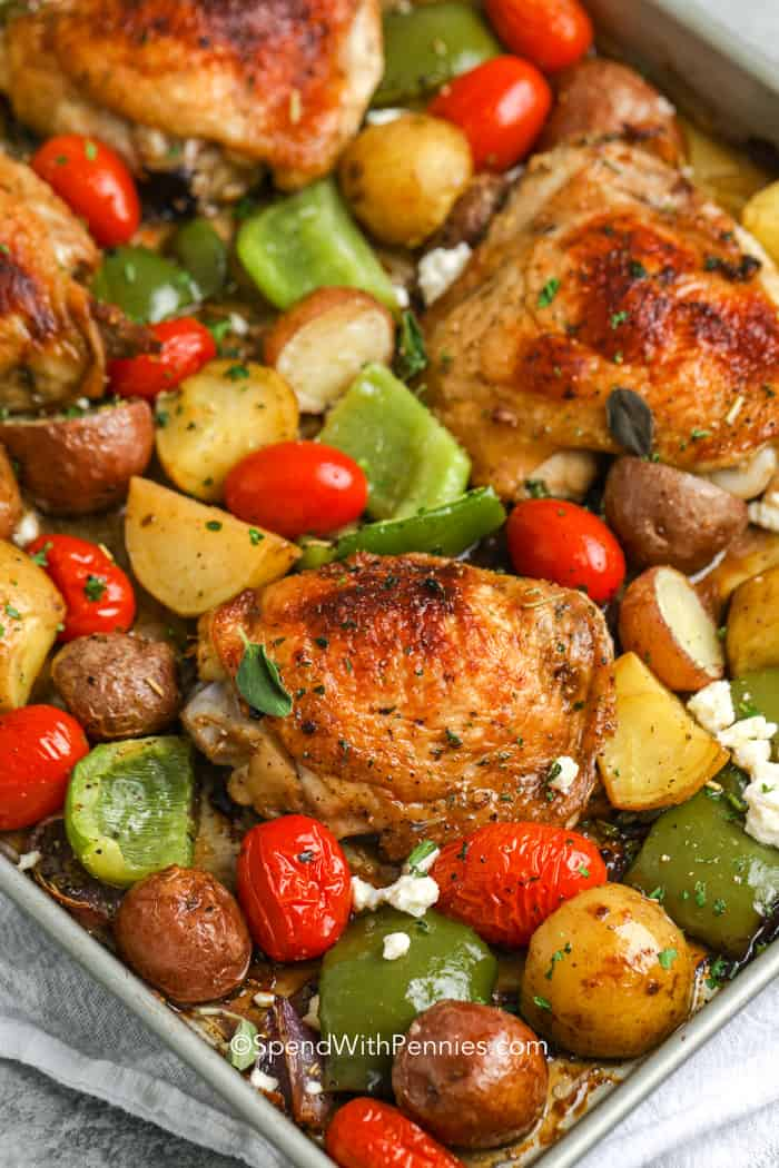 Baked chicken, onions, potatoes, peppers and tomatoes