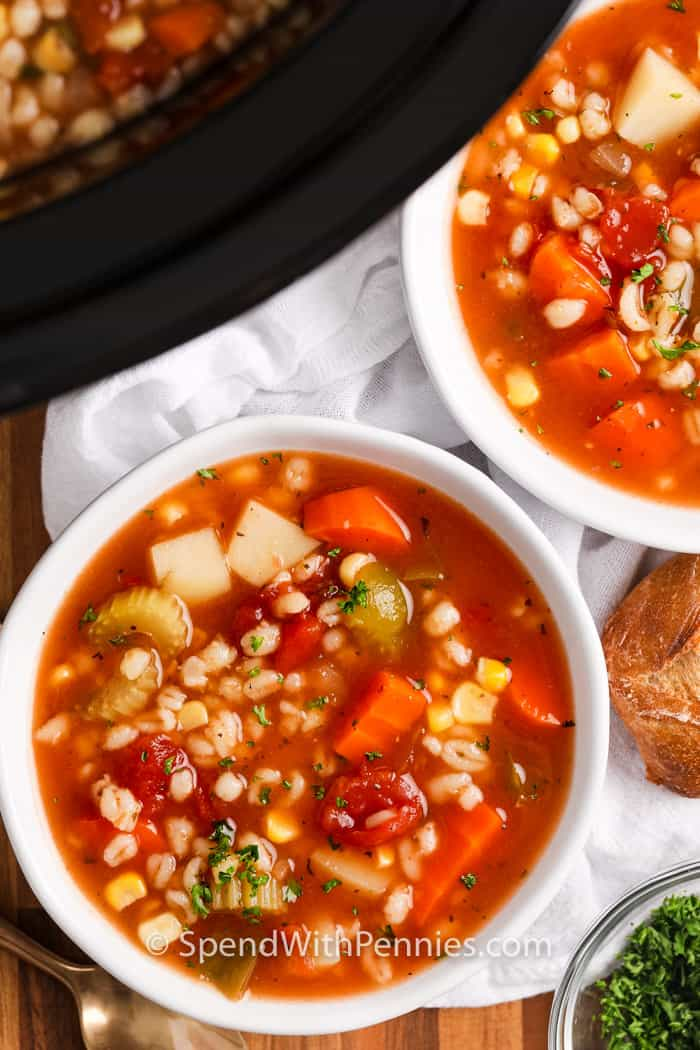 Overview of two bowls of vegetable barley soup