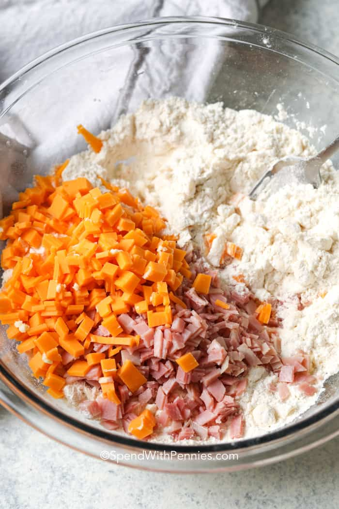 ingredients for ham and cheese biscuits in a bowl