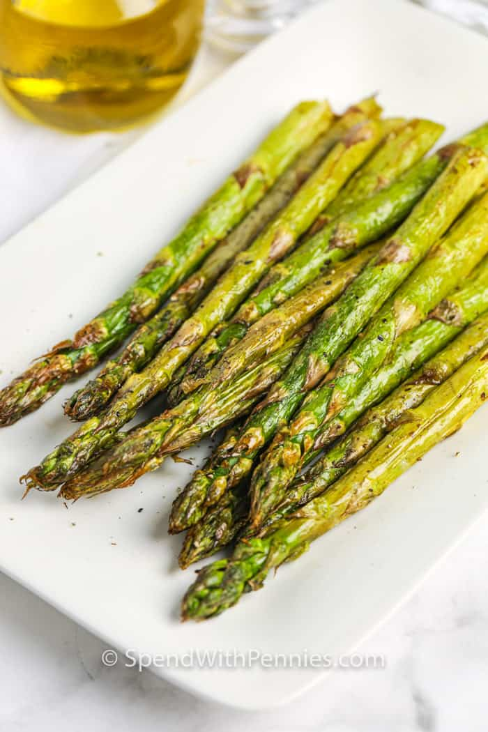 Air fryer asparagus on a serving tray