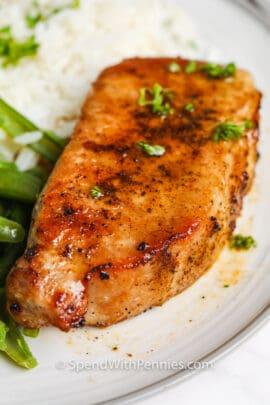 Close up of an air fryer pork chop