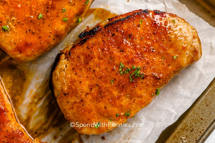 Close up of a baked pork chops garnished with parsley