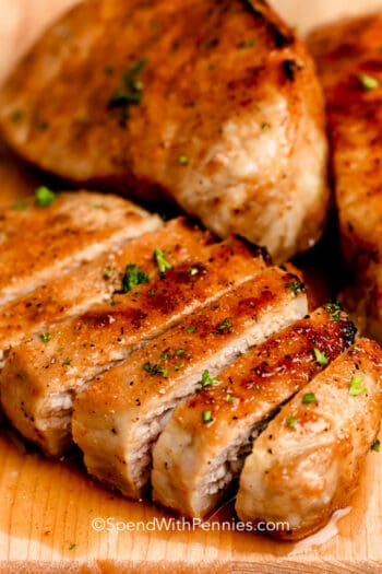 A baked pork chop sliced into strips