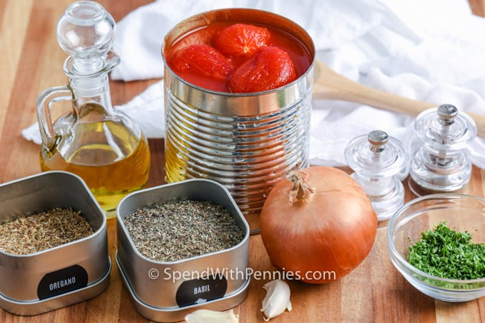 Ingredients for tomato sauce on a wooden board