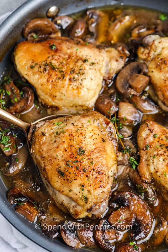 Braised Mushroom Chicken Thighs in a frying pan