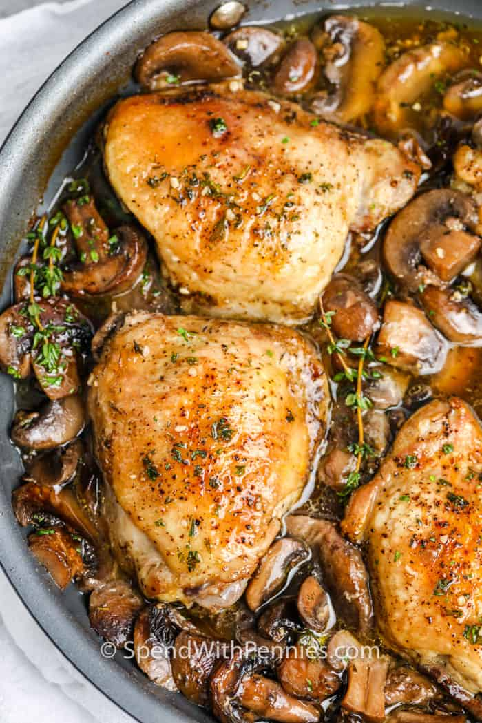 Braised Mushroom Chicken Thighs in a frying pan after its cooked