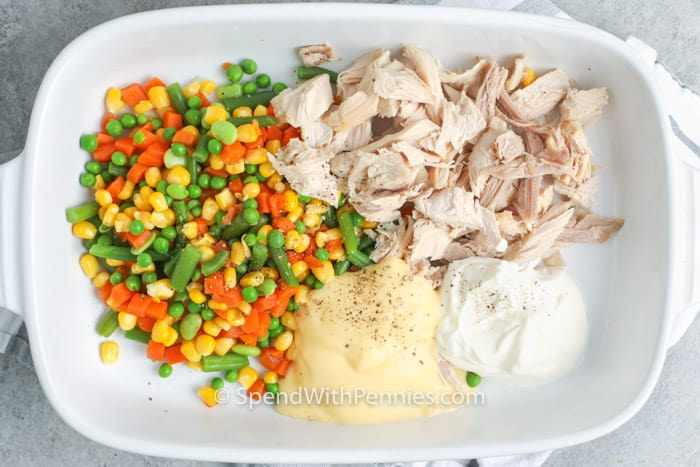 ingredients for chicken stuffing casserole in a casserole dish