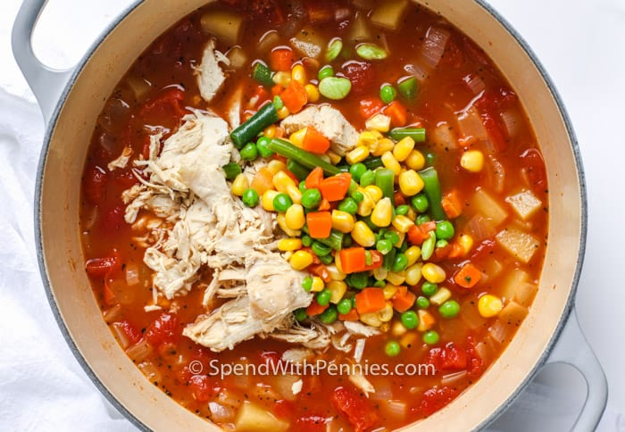 Overview of chicken and vegetables being added to the stock pot.