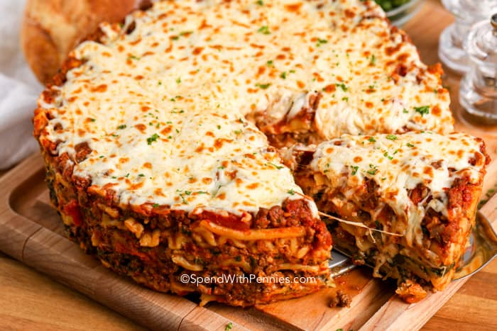 Instant pot lasagna being served from a wood board