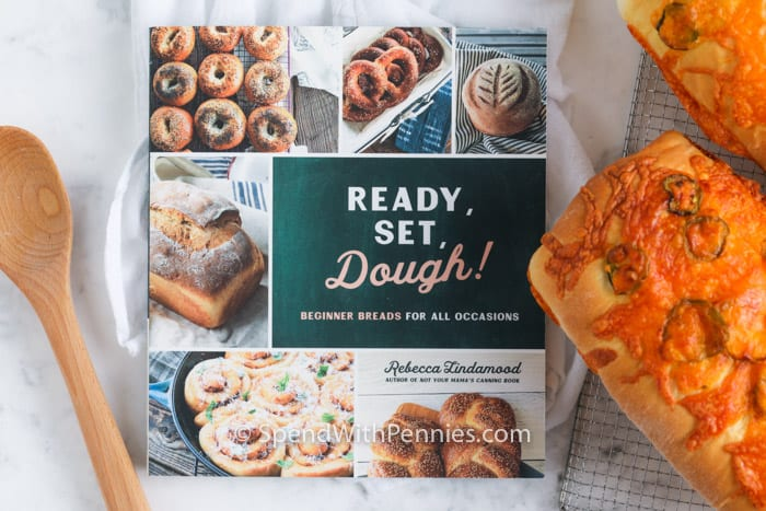 Ready, Set, Dough cookbook with two loaves of Jalapeno Cheddar bread to the side