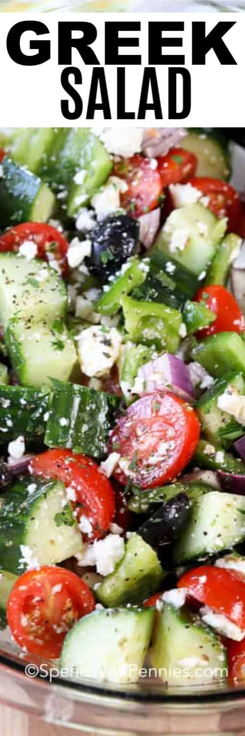 Greek Salad in a clear bowl with title