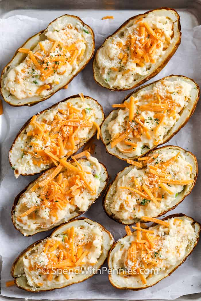 Loaded Baked Potatoes on a baking sheet before cooking