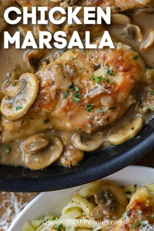 Chicken Marsala in a black pan with a serving of chicken marsala over pasta on the side, with writing