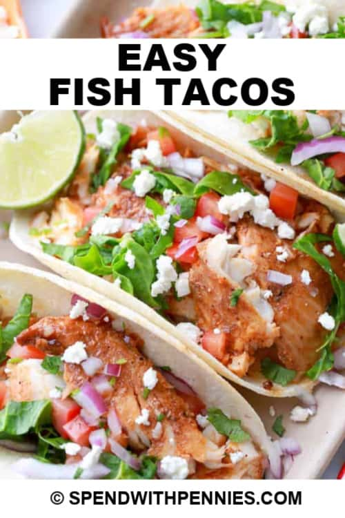 Fish Tacos in a tray with toppings and lime, with a title