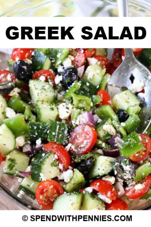 Greek Salad with a silver spoon with title
