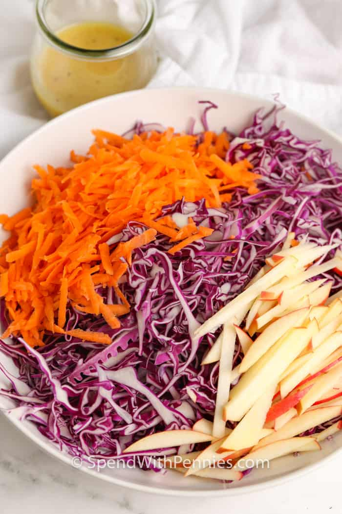 Red cabbage slaw ingredients in a white bowl
