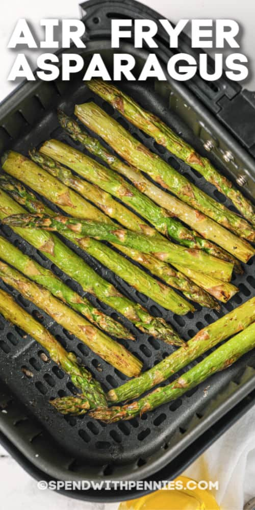 Air Fryer asparagus cooked in an air fryer basket with writing