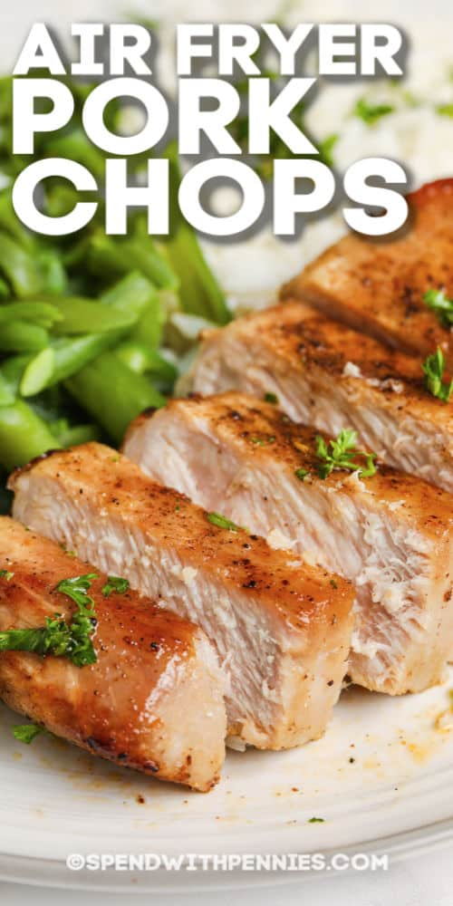 sliced air fryer pork chop served with green beans and rice with writing