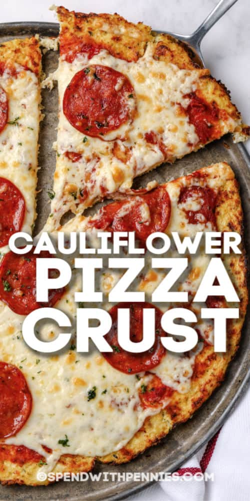 cauliflower pizza being served with writing