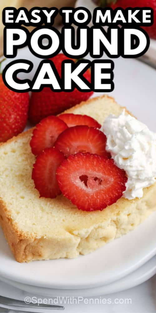 Piece of pound cake on a white plate with strawberries whipped cream and writing