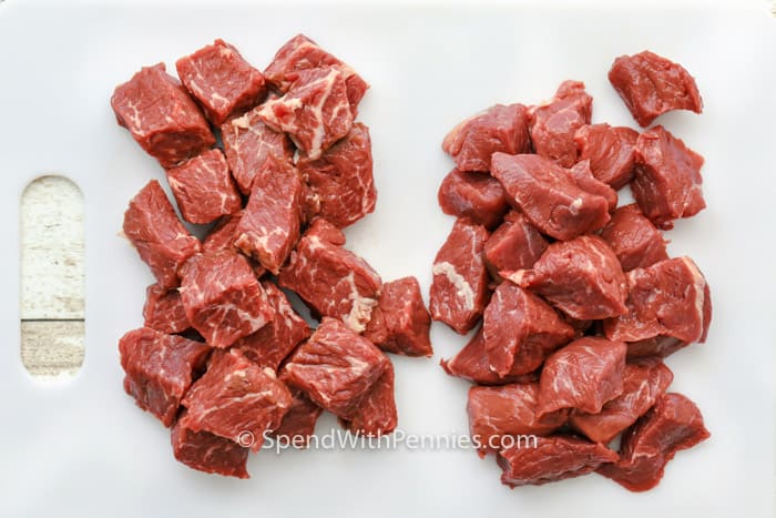 Stew meat cubed on a cutting board