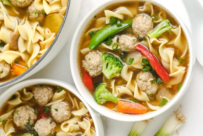 unwrapped wonton soup in bowls with mini meatballs