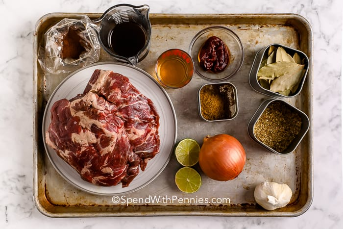Beef Barbacoa ingredients on a baking sheet